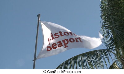 Historic Seaport Flag waving in the wind in Key West harbor