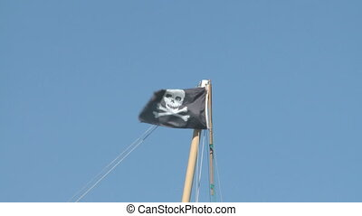 Pirate Flag waving in the wind in Key West harbor