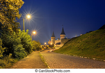 Night old town with a fortress - Night landscape with a road...