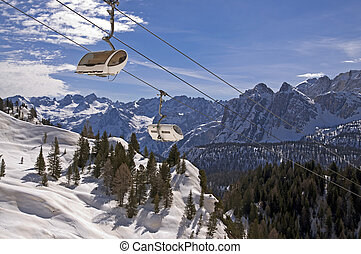 Ski slope in Dolomites, Italy - Ski slope and cable car in...