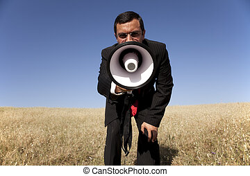Businessman shouting at the megaphone to you - businessman...