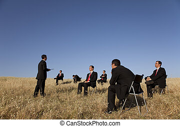 business outdoor training, with a presentation for a group...