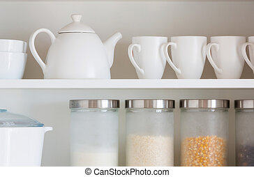 white kitchenware - opened cupboard with kitchenware inside