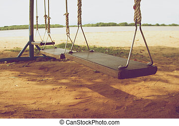 Wooden swings on beach vintage - Wooden swings on beach near...
