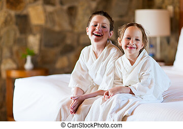 Brother and sister at hotel room - Two kids brother and...