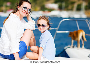 Family sailing on a luxury yacht - Mother, daughter and...