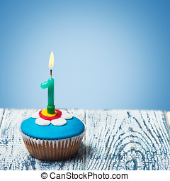 Cupcake with number one on a blue background birthday...