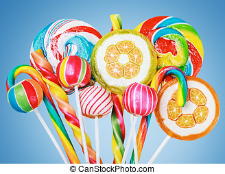 Colorful candies and sweets on a blue background