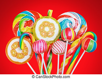 Colorful candies and sweets on a red background
