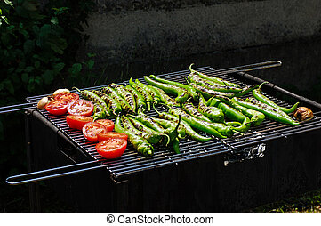Barbecue with vegetables - Tomatos and paprika on a grill
