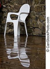 White chair reflection - Coffee shop white chair against a...