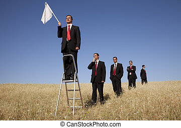 Get in line to fail - a group of businessman in the field...