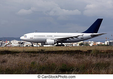 Plane landing - View of a commercial plane landing on a...