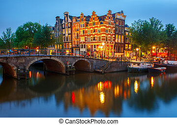 Night city view of Amsterdam canal and bridge - Night city...
