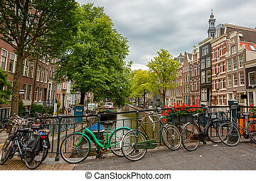 City view of Amsterdam canals and typical houses, Holland,...
