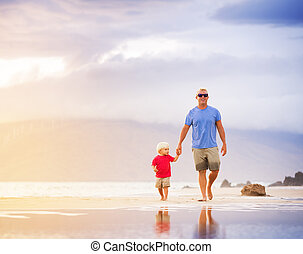 Father and Son - Happy father and son walking on the beach...