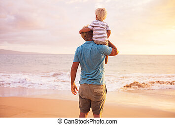 Father and Son - Father and son playing at sunset
