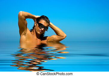 Sexy man half body in water - Young man with sexy body on...