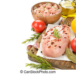 Raw chicken with spices on white background