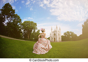 Princess in an vintage dress before the magic castle - A...