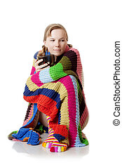 Woman in blanket with a large cup