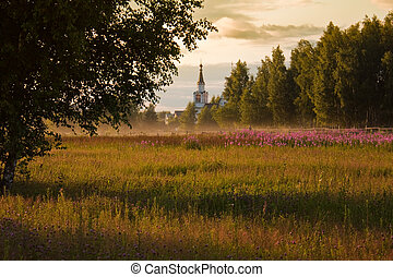 rural church - rural summer landscape with field of flowers...