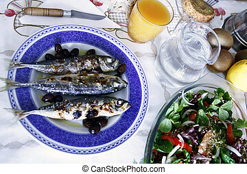 Grilled mackerel - On the table, grilled mackerels poured...