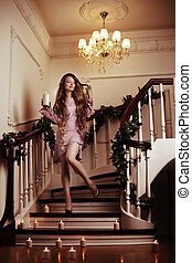 Rich woman on staircase with a candle - Beautiful rich woman...