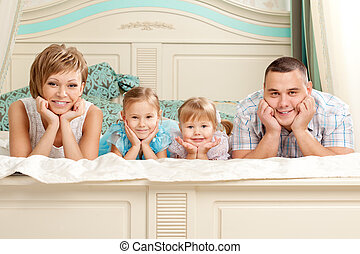 Happy family smiling at home
