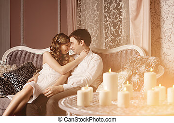 Happy couple in love at home - Happy Couple in love hugs at...