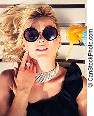 woman sunbathing on a chaise lounge - Fashion beautiful...