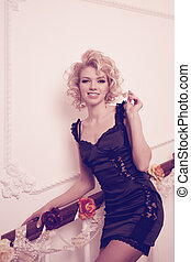 Splendid woman on staircase - Splendid young woman on...