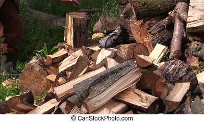 Peasant chop wood - Peasant worker man chop wood nead...