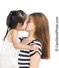 Happy asian little girl with her mother.