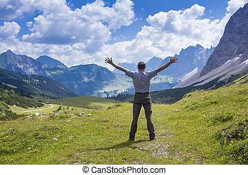 happy man is standing on a hill