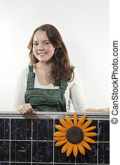 female worker with photovoltaic module on white background