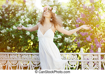 Young beauty woman with opened arms outdoors - Woman with...