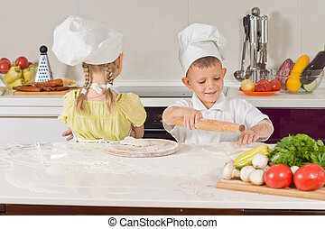 Two Very Young Chefs Making Food While Talking