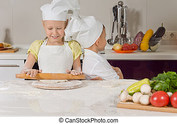 Cute little girl learning to bake
