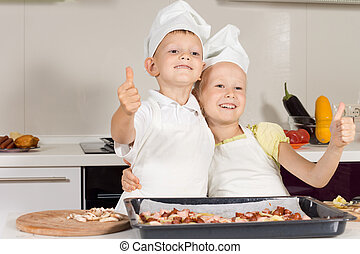Two Little Chefs Showing Thumbs Up Emphasizing Good Job in...