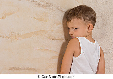 Cute Little Mad Boy Isolated on Light Brown Walls - Cute...