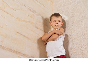 Serious Little Kid Isolated on Wooden Walls - Serious Little...