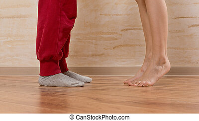 Two Little Feet on Wooden Floor - Two Little Feet, Face to...
