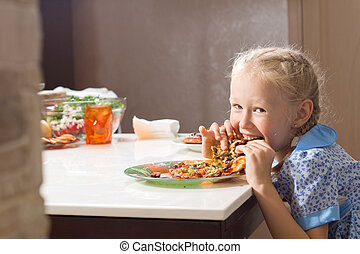 Hungry pretty little girl devouring homemade pizza looking...