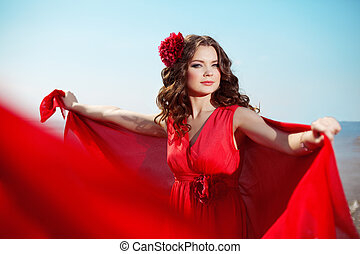 Beautiful woman in a bright red dress