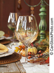 Fall dining table with focus on wine glass - Fall dining...