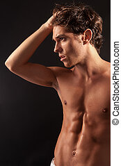 Young sexy male adult - Studio shot of a young sexy male...