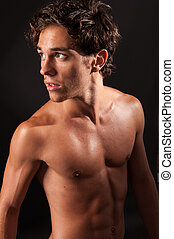 Young sexy male with naked torso - Studio shot of a young...