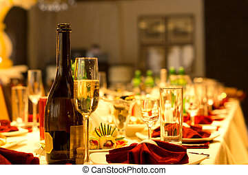 Champagne on a formal dinner table - Champagne in a bottle...