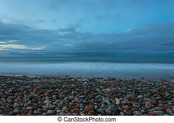 Ocean beach at the crack of dawn Lawrencetown Beach, Nova...